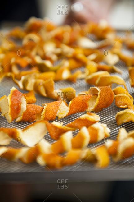 Orange peels drying on a tray