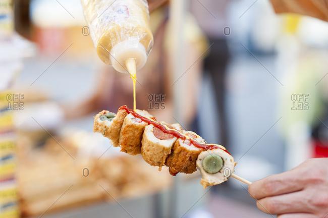 Fried hotdogs on a stick in Korea