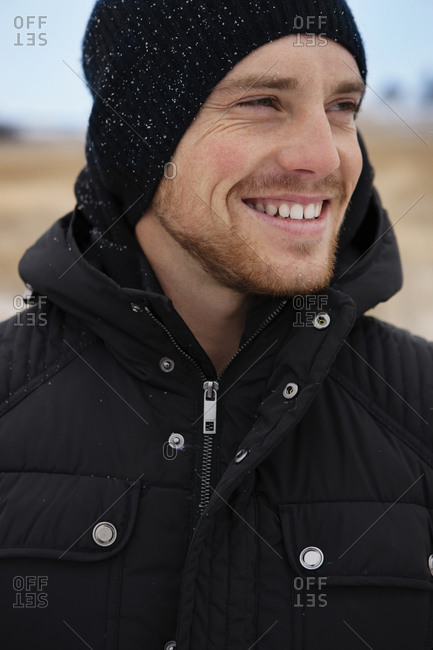 Smiling young man in winter field