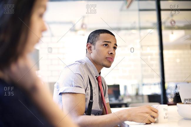 Man with a mug on a meeting