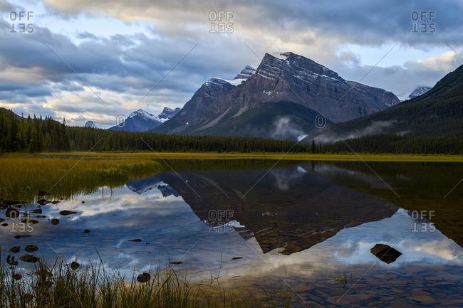 Mountain reflected in Waterfowl Lake at sunrise, Banff National Park, Alberta, Canada