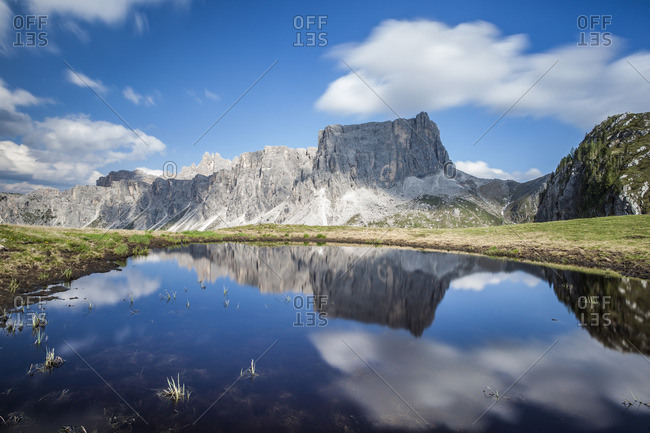 The Lastoni de Formin reflecting in the Lake at Passo Giau,  Italy