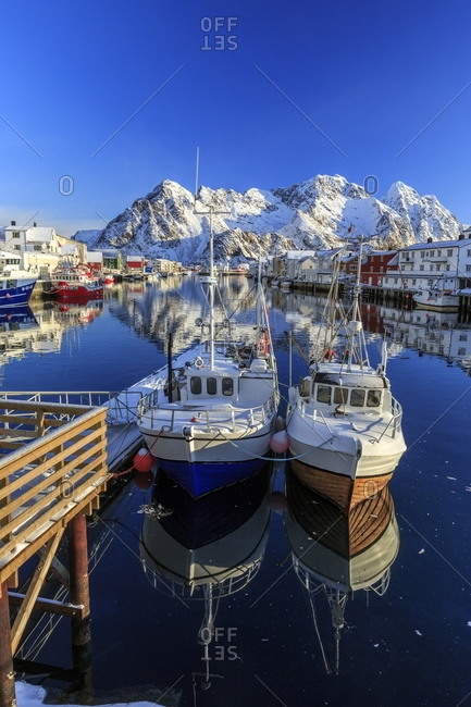 Boats moored at the port of Henningsvaer in the Lofoten Islands, Norway