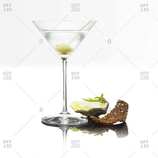 Glass of gin martini, oysters and bread