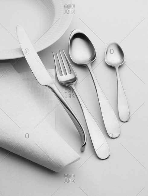 Fine cutlery, plate and napkin