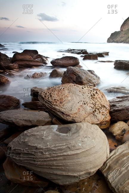 Rocks on coastline at Putty Beach