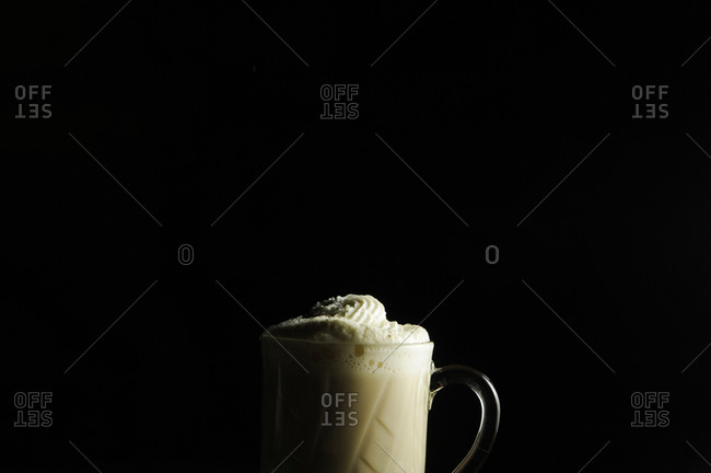 A coffee drink with whipped cream