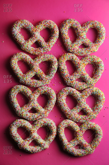 Two lines of yogurt-covered pretzels covered in nonpareils