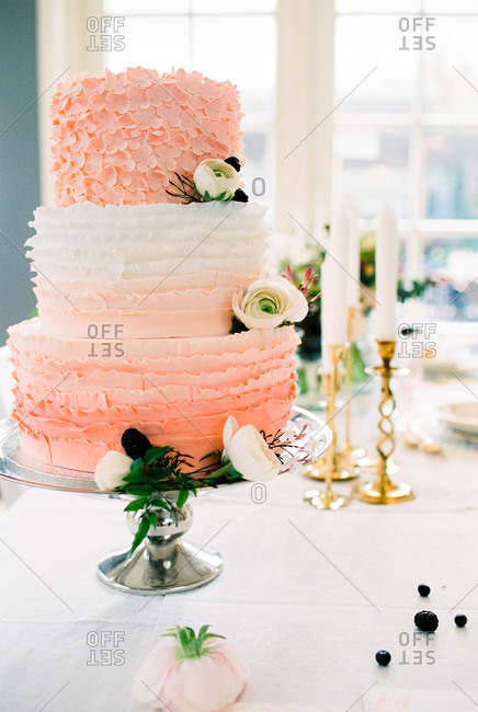 Three-tiered wedding cake decorated with flowers