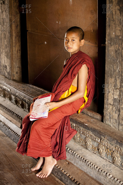 Kan Gyi, Myanmar - August 22, 2011: Novice monk with book in Shwe Yaunghwe Kyaung monastery, Myanmar