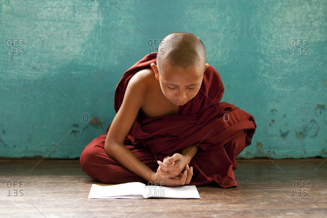 Kan Gyi, Myanmar - August 22, 2011: Novice buddhist monks studying in Kan Gyi Kyaung monastery