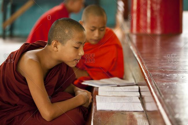 Kan Gyi, Myanmar - August 22, 2011: Novice monks studying in Kan Gyi Kyaung monastery