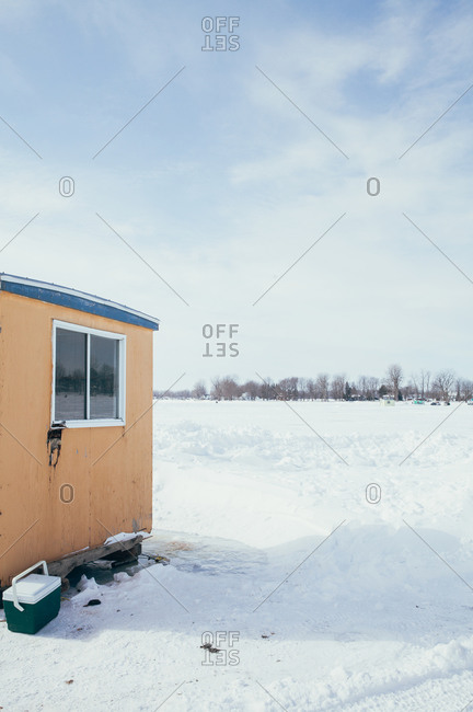 Corner of ice fishing shack on frozen lake