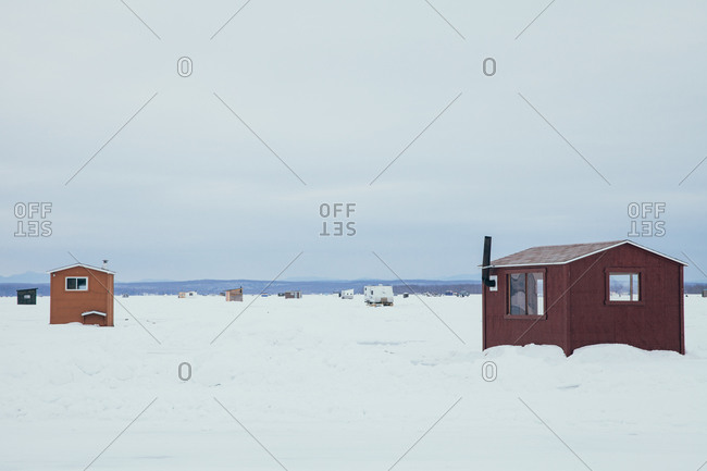 Temporary fishing shelters on a frozen lake