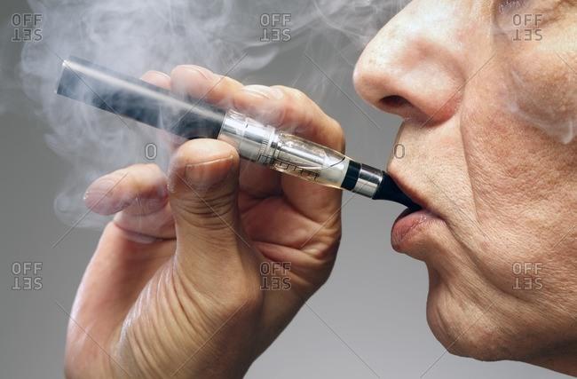Person smoking an electronic cigarette