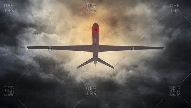 Illustration of an unmanned drone flying in a stormy sky