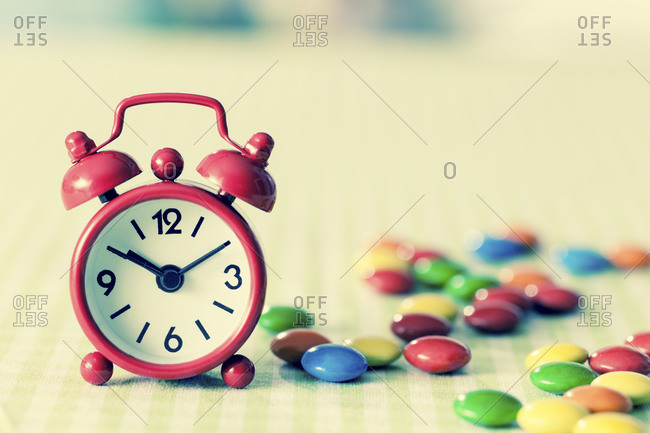Alarm clock and confectionery