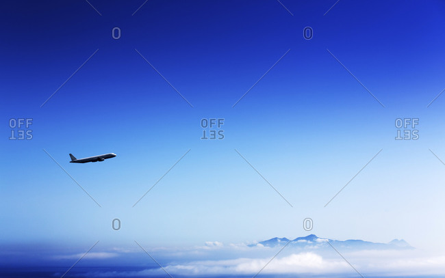 Airplane flying in the clear blue sky