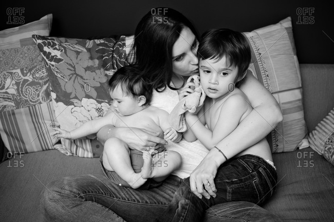A mother holds her two children