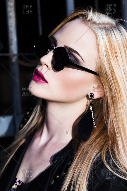 Portrait of rouged blond woman wearing sunglasses