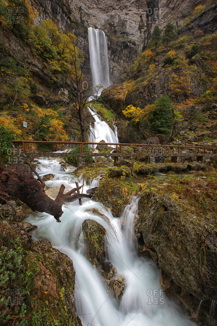 Waterfalls and bridge at the source of Mundo river in autumn
