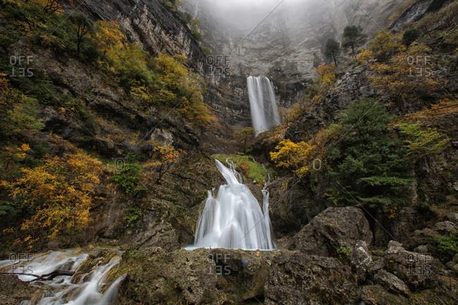 Looking up at waterfalls at the source of Mundo river