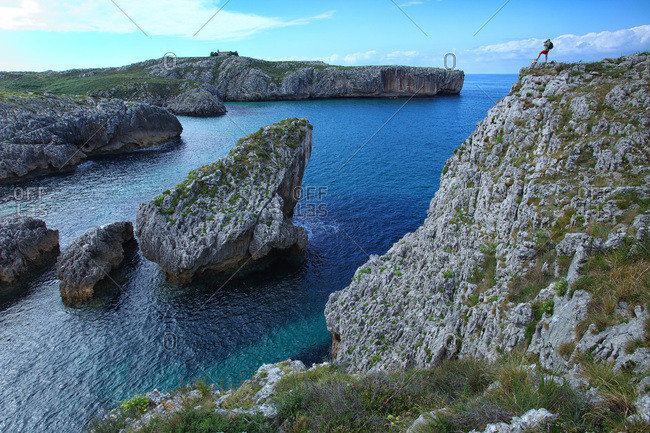 Cove San Antonio with hermitage of Llanes in background