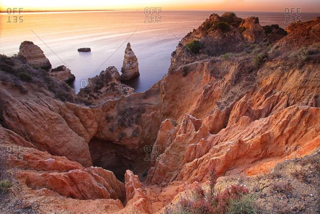 Rock formations off the coast of Algarve at dusk