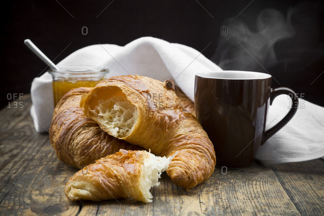 Croissants with fig jam and cup of hot coffee
