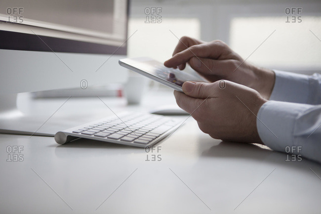 Man's hand using touchscreen of digital tablet