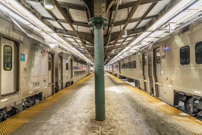 Hoboken, New Jersey, USA - February, 17, 2015: Commuter trains at platform in Hoboken Station