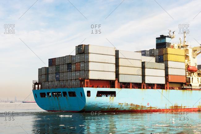 New York, NY, USA - February, 22, 2015: Loaded container ship in New York Harbor
