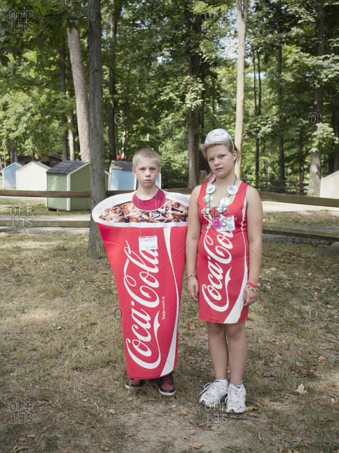 Twinsburg, Ohio - August, 2012: Two fraternal twins dressed like soda containers at a twin festival in Ohio