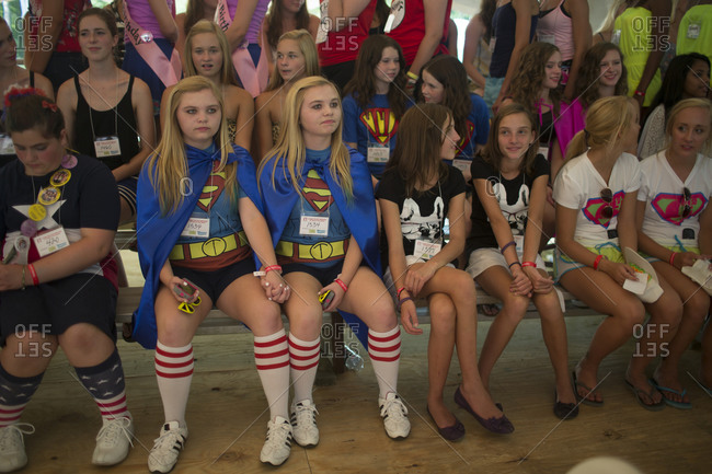 Twinsburg, Ohio - August, 2012: Identical twin sisters gather on stage to await judging in a look-alikes during the annual Twins Days Festival