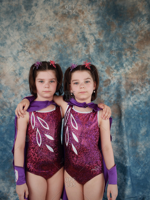 Twinsburg, Ohio - August 4, 2012: Identical twin sisters posing for a portrait during the annual Twins Days Festival