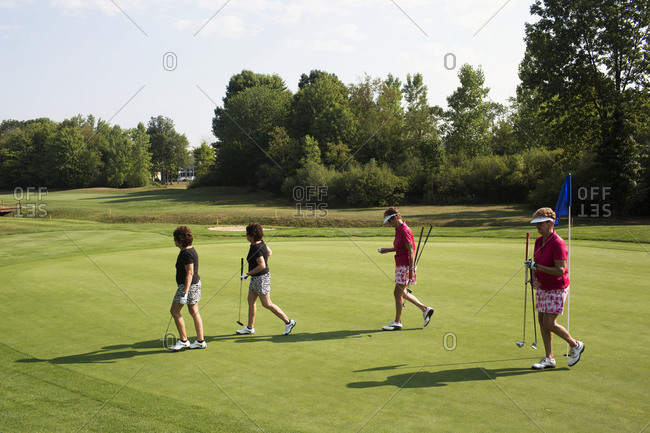 Twinsburg, Ohio - August 3, 2012: Identical twin sisters playing a golf tournament during the annual Twins Days Festival