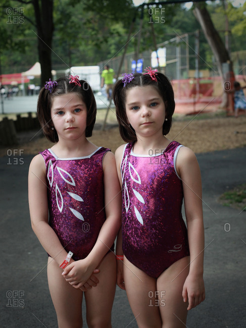 Twinsburg, Ohio - August 4, 2012: Identical twin sisters in bathing suits during the annual Twins Days Festival