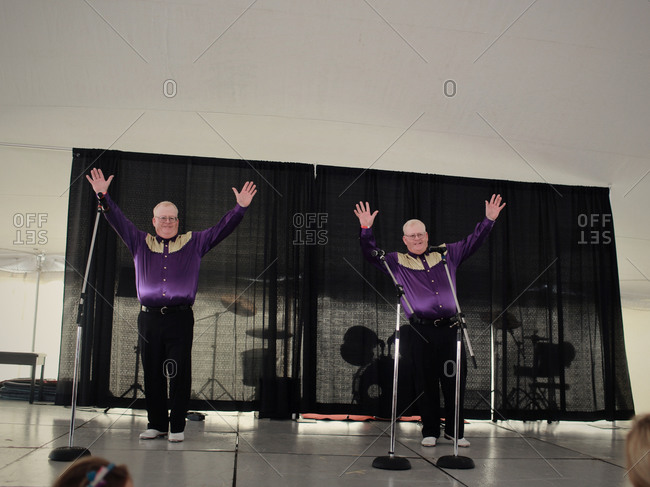 Twinsburg, Ohio - August 4, 2012: Identical twin brothers tap dancing in the talent competition during the annual Twins Days Festival
