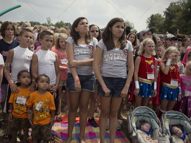 Twinsburg, Ohio - August 4, 2012: A crowd of twins gather for a group photo at the annual Twins Days Festival