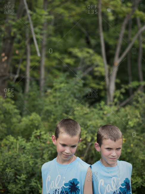 Twinsburg, Ohio - August 5, 2012: Adolescent identical twin brothers at the annual Twins Days Festival