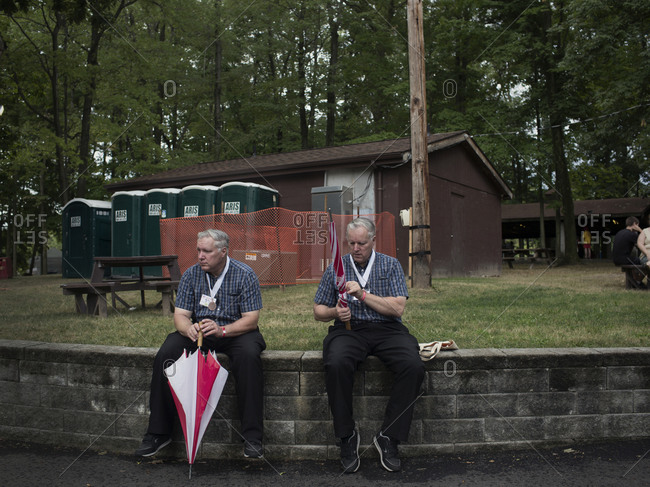 Twinsburg, Ohio - August 5, 2012: Adult twins with umbrellas at the annual Twins Days Festival