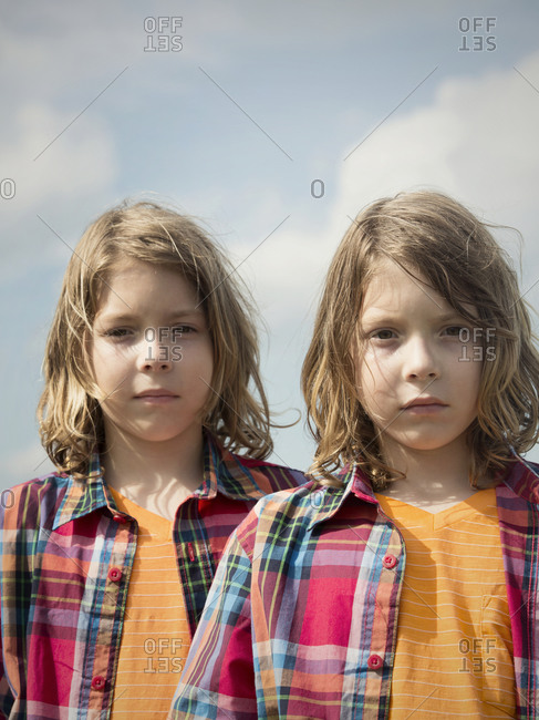Twinsburg, Ohio - August 5, 2012: Twin brothers in plaid shirts at the annual Twins Days Festival