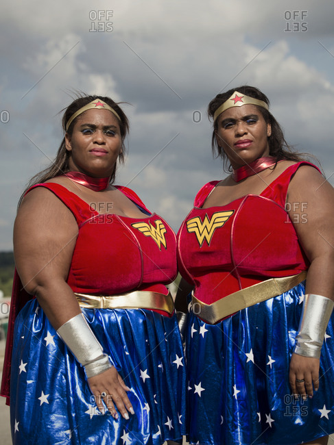 Twinsburg, Ohio - August 5, 2012: Twin sisters dressed in superhero costumes at the annual Twins Days Festival