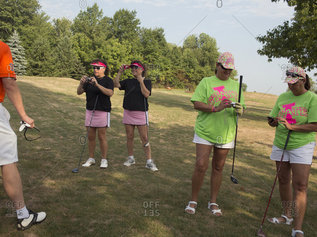 Twinsburg, Ohio - August 3, 2012: Twins on the golf course take photos at the annual Twins Days Festival