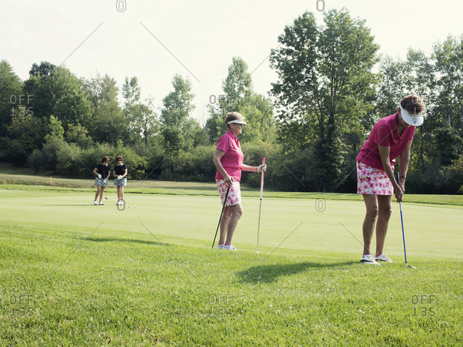 Twinsburg, Ohio - August 3, 2012: Twins on a golf course at the annual Twins Days Festival