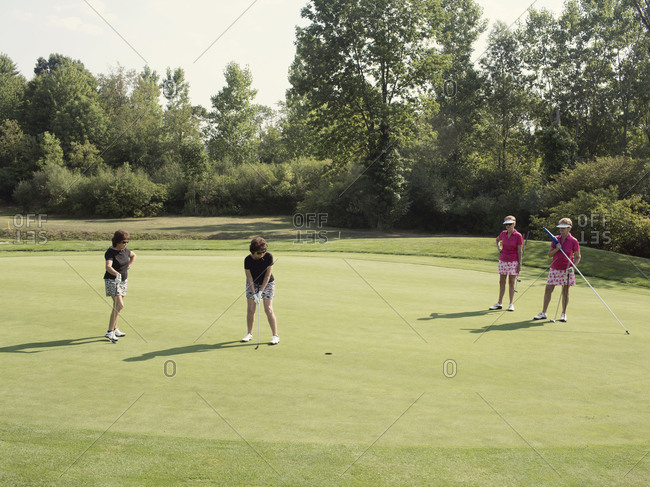 Twinsburg, Ohio - August 3, 2012: Identical twin sisters play in a golf tournament during the annual Twins Days Festival