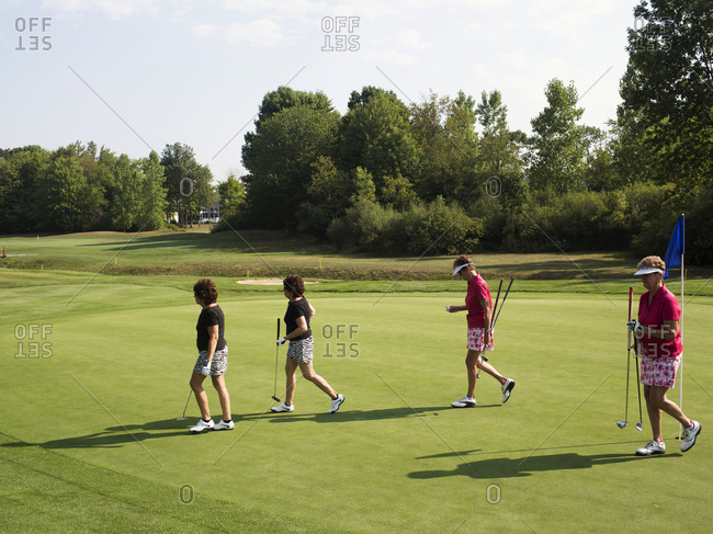 Twinsburg, Ohio - August 3, 2012: Twin sisters play in a golf tournament during the annual Twins Days Festival