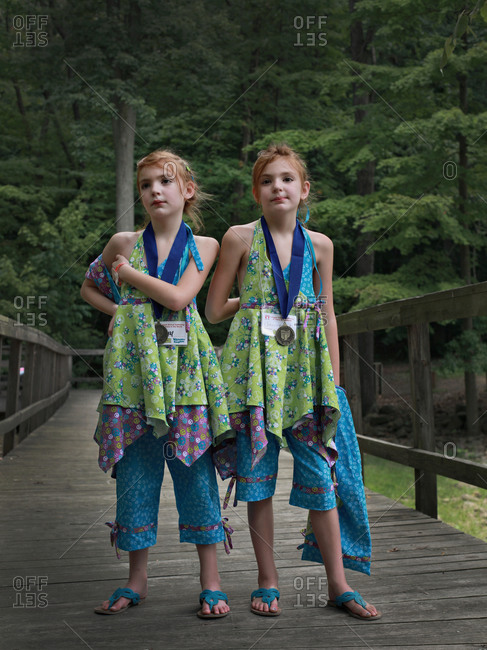 Twinsburg, Ohio - August 4, 2012: Twin sisters on a bridge at the annual Twins Days Festival