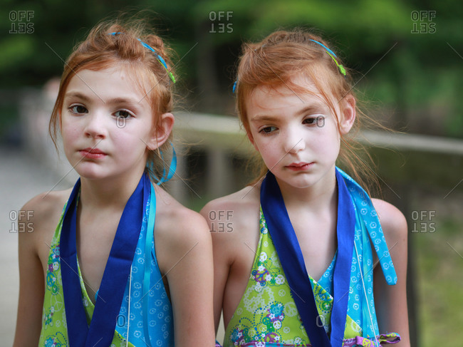Twinsburg, Ohio - August 4, 2012: Redhead twins on a bridge at the annual Twins Days Festival