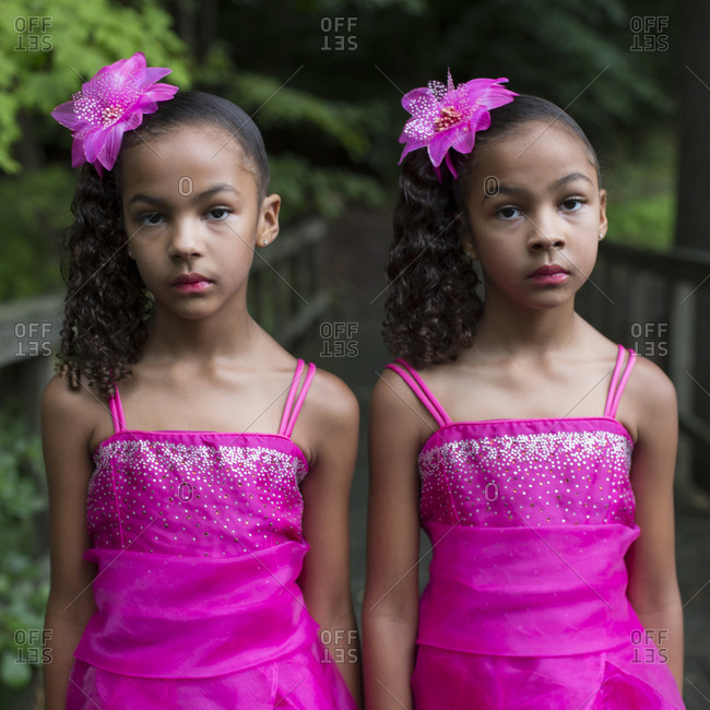 Twinsburg, Ohio - August 5, 2012: Twin sisters in hot pink dresses at the annual Twins Days Festival
